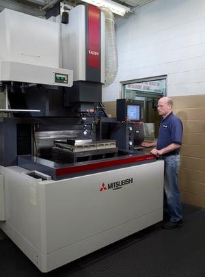 Rodon employee operates a cnc machine