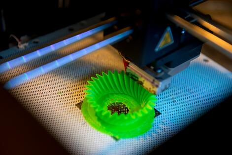 Green spiral component being printed using a 3d printer