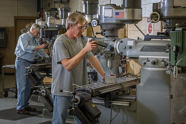 Rodon employees using machining equipment in Rodon's facility