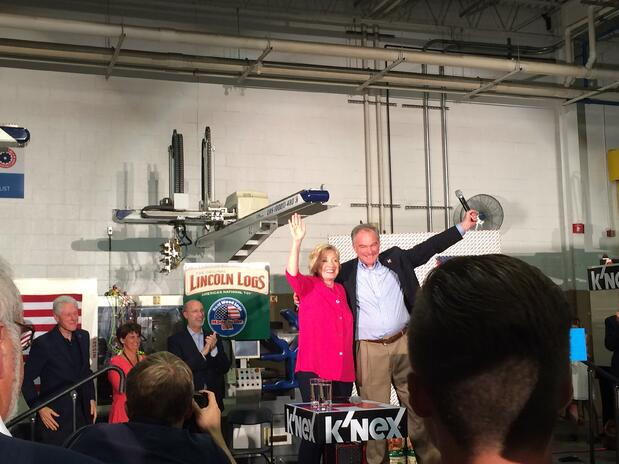 Hillary Clinton stands on stage in Rodon facility in front of crowd