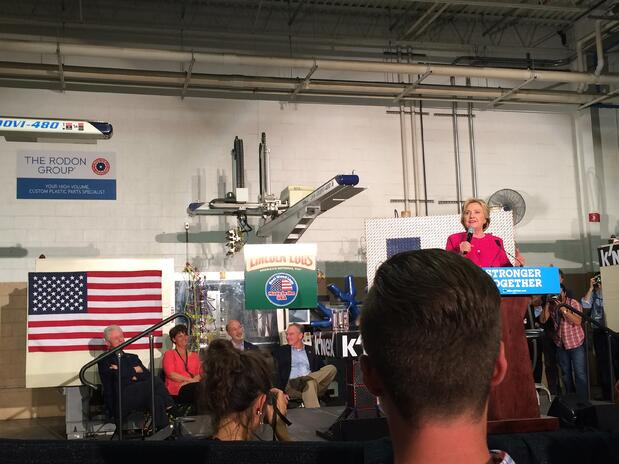 Hillary Clinton speaks to a group of employees at Rodon's facility