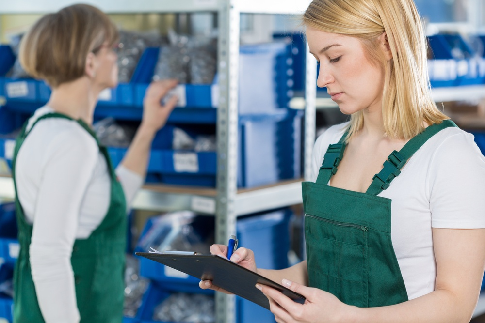 Youthful attractive girl is checking the product list.jpeg
