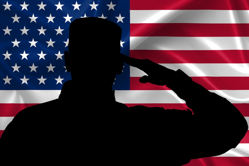 outline of a soldier saluting in front of an American flag