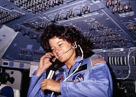 Sally Ride floating in zero gravity inside the spacecraft